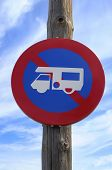 stock photo of motorhome  - No campervans or motorhomes sign on a beach - JPG