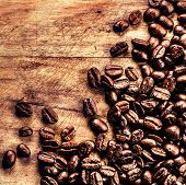 Coffee On Grunge Wooden Background Closeup. Roasted  Coffee Beans On Vintage Table Macro.