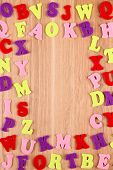 English alphabet on wooden background