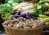 stock photo of root-crops  - Potatoes and other vegetables for sale on a market - JPG