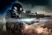 picture of assault-rifle  - Soldier in uniform with rifle - JPG
