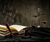 stock photo of honesty  - Scales and wooden hammer on judge - JPG