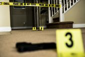 picture of crime scene  - A crime scene with number markers and evidence on the floor - JPG