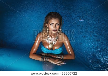 Sensual Blonde Woman In Water
