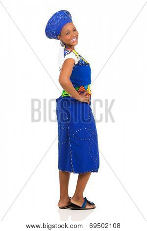 happy african woman in traditional attire with her hands on her hips