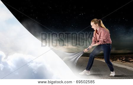 Young woman in casual turning page of reality