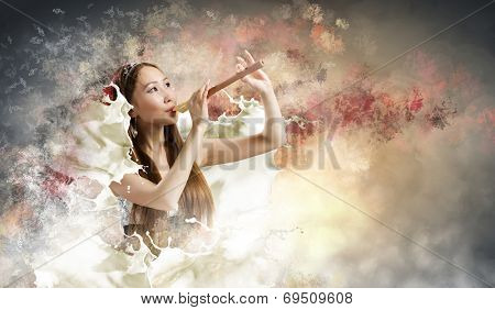 Young asian woman against colorful background playing fife