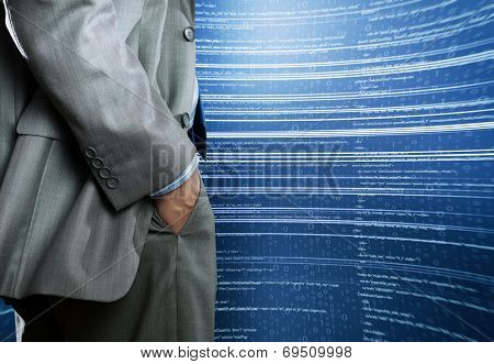 Bottom view of businessman and digital background