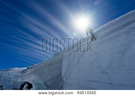 Low angle view of man climbing glacier