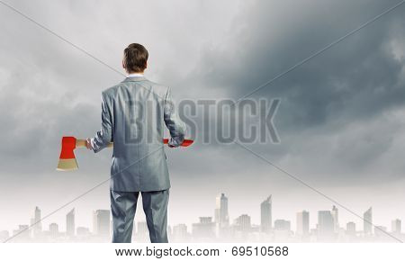 Young businessman with red axe
