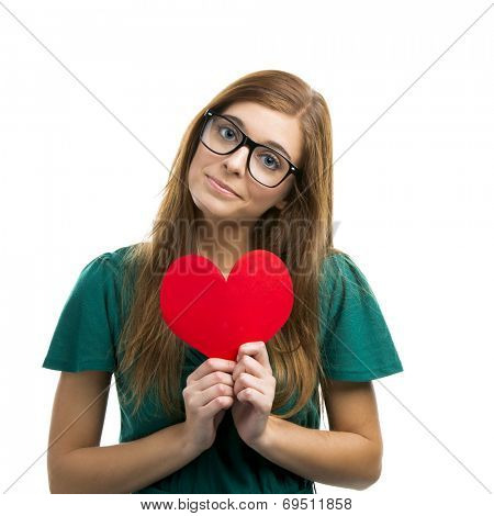Beautiful blonde girl holding a hearth