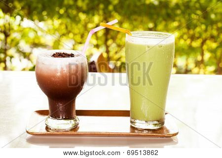 Iced Green Tea Latte And Iced Cocoa In A Glass.