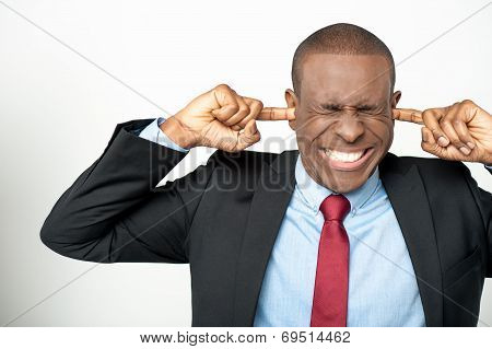Businessman Hold Hands On Temples Ears