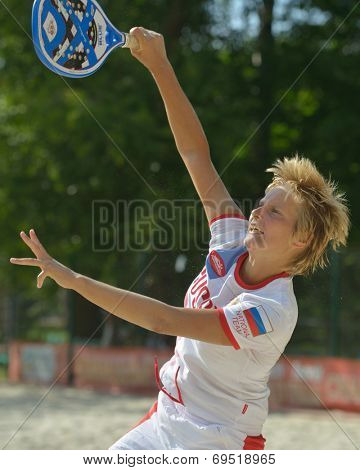 MOSCOW, RUSSIA - JULY 17, 2014: Daria Churakova of Russia on the training during the ITF Beach Tennis World Team Championship. Russia hosts the championship for the third time