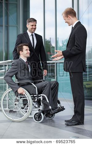 Disabled Businessman Talking With His Co-workers