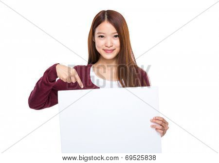 Woman finger point down to placard