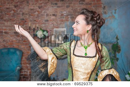 Beautiful Woman In Medieval Dress Stretching Hand To Something