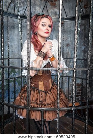 Praying Beautiful Steampunk Woman In The Cage