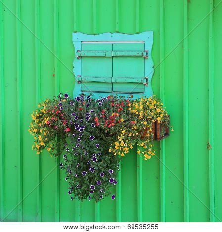 Wooden Green Painted Boathouse Facade, Closed Window With Flower Box