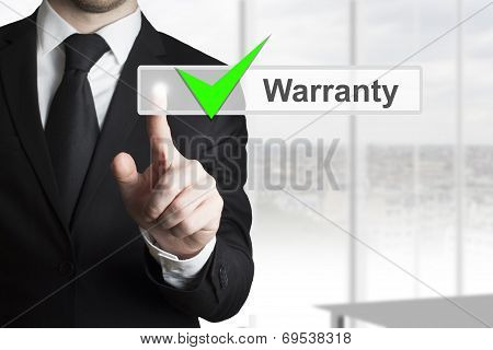 Businessman Pushing Touchscreen Warranty Green Check