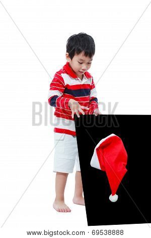 Little Boy Looking Santa Hat With The Blackboard ,isolated On White