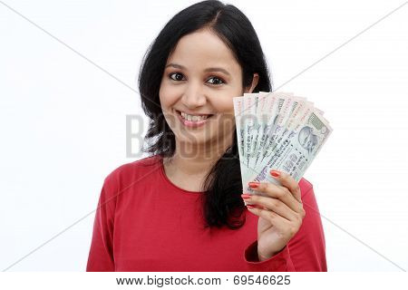 Young Woman Holding Indian Currency