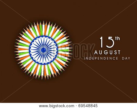 Stylish Asoka wheel with national tricolors ribbons on brown background for 15th of August, Indian Independence Day celebrations.