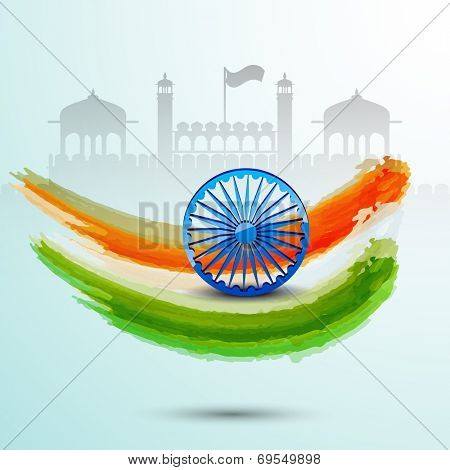 Indian Independence Day celebrations with saffron and green color with Asoka Wheel on red fort silhouetted blue background.