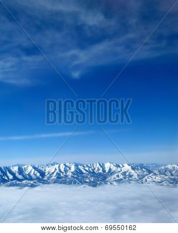 Mountaintops Above the Clouds