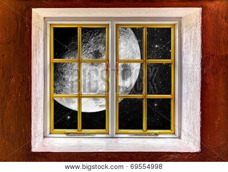 Big Moon And A Starry Night Seen Through A Window