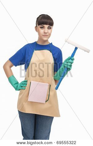 Cleaning Concept: Happy Caucasian Female Holding Rubber Swab And Smiling