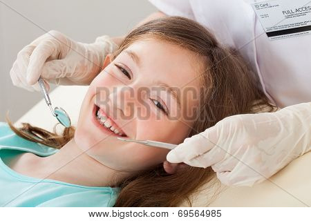 Happy Girl Undergoing Dental Treatment