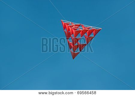 Crazy Red Tetrahedral Kite With Blue Sky