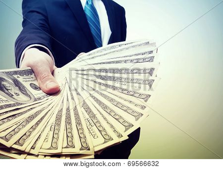 Business Man Displaying A Spread Of Cash