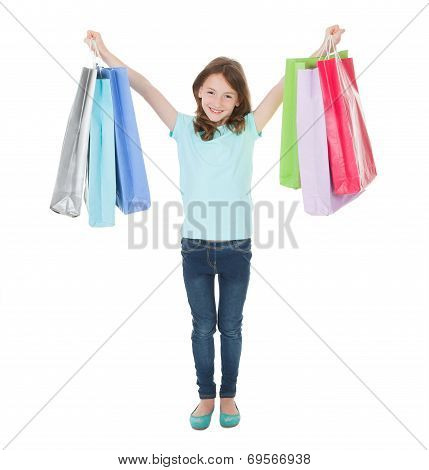 Portrait Of Smiling Girl Carrying Shopping Bags