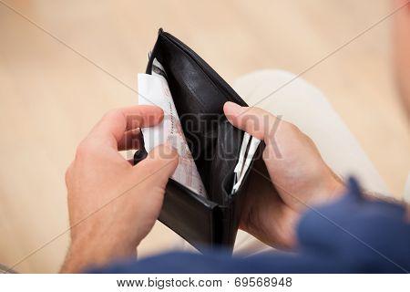 Broke Man Holding Wallet