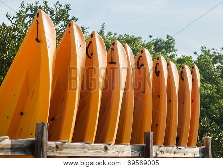 Prows Or Front Of Many Plastic Kayaks Or Canoes