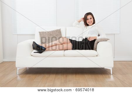 Businesswoman Sitting On Sofa At Home