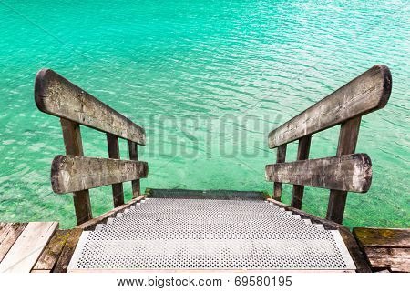 wooden banister of the pier with water