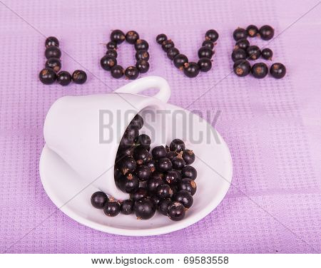Inverted White Cup With Black Currants