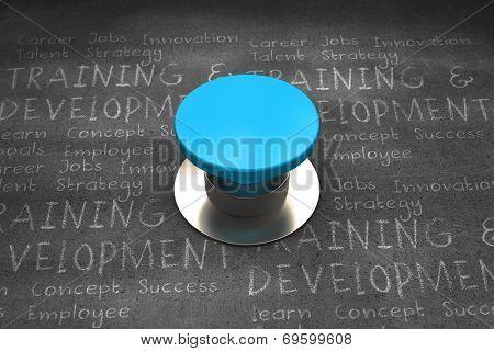 Blue push button against black wall