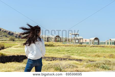 Side portrait of single girl turns around with flying hair