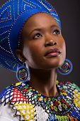 picture of zulu  - cute african zulu girl in traditional clothes looking up - JPG