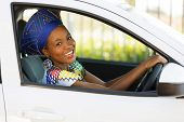 image of zulu  - beautiful young african woman driving a car - JPG