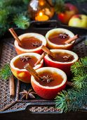 foto of cider apples  - Apple cider with cinnamon sticks and anise star in apple cups - JPG