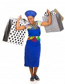 stock photo of zulu  - cheerful african zulu woman carrying shopping bags on white background - JPG