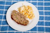 stock photo of meatloaf  - Traditional meatloaf with macaroni and cheese on plate - JPG