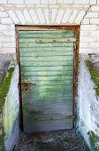 stock photo of basement  - Old door leading to an underground basement - JPG
