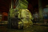 foto of medusa  - A large Medusa head supports a column at the Basilica Cistern in Istanbul - JPG