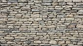 image of old stone fence  - Old stone wall texture - JPG